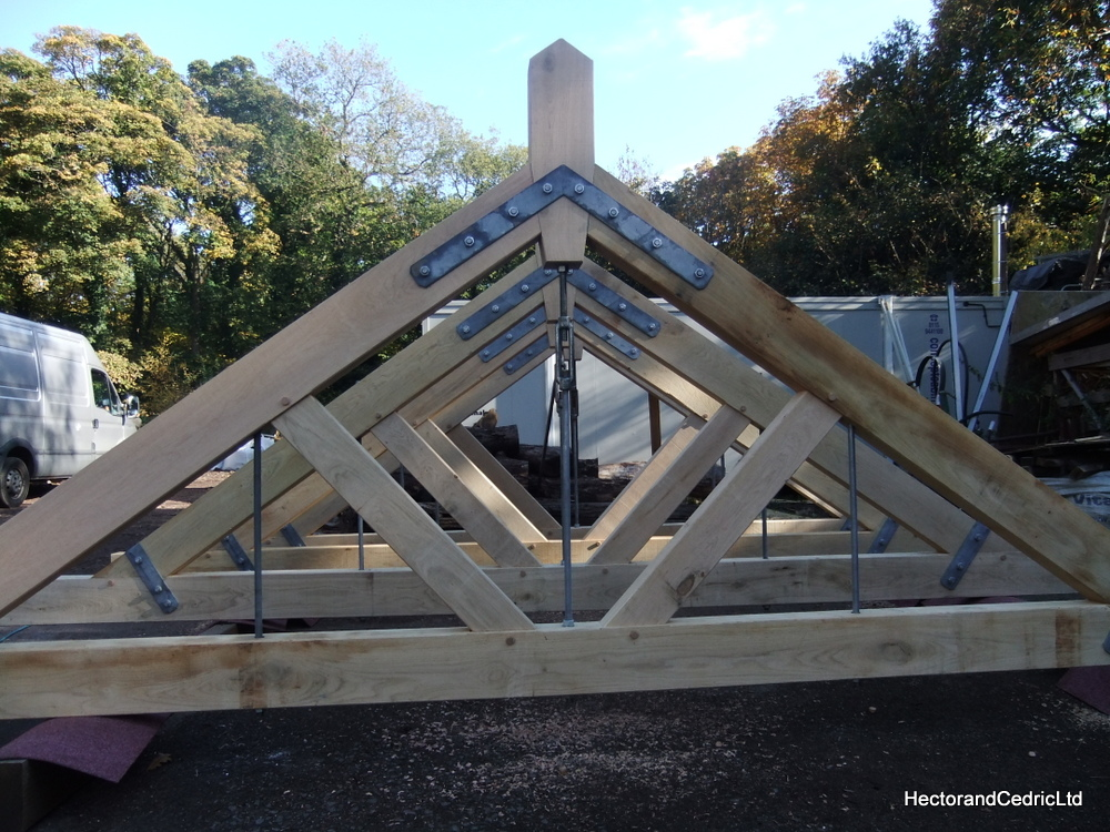 Industrial style oak king post roof trusses hector and for Price on roof trusses