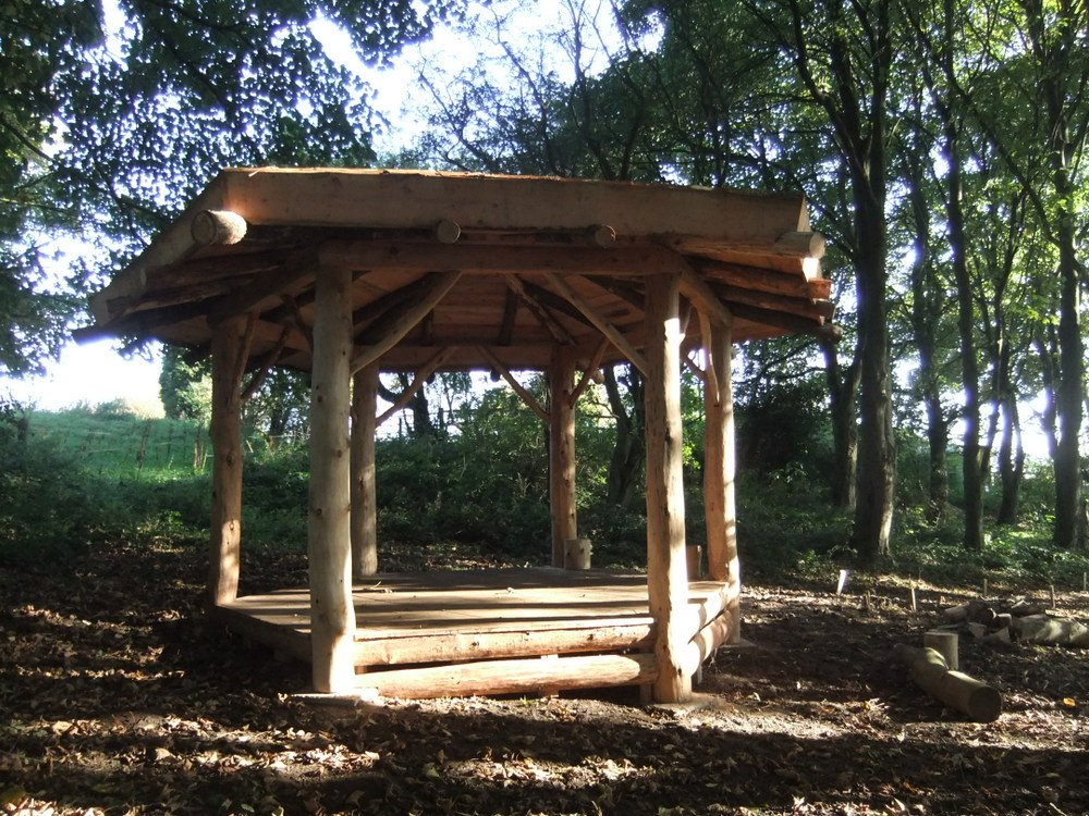 Round house shelters hector and cedric for Round garden buildings